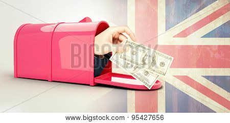 Hand holding hundred dollar bills against union jack flag in grunge effect