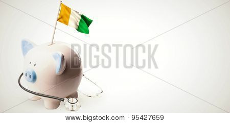 Ivory coast national flag on flagpole against white background with vignette