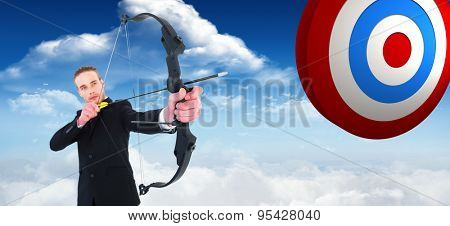 Concentrated businessman shooting a bow and arrow against bright blue sky with clouds