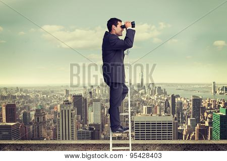 Businessman standing on ladder against balcony overlooking city
