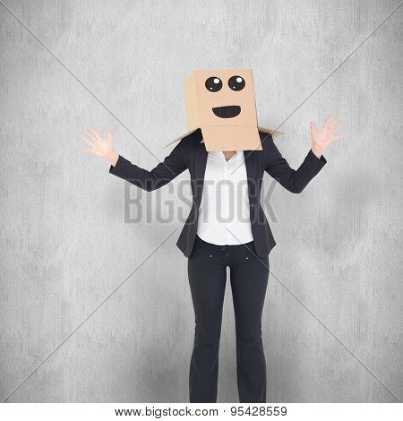 Businesswoman with box over head against white background