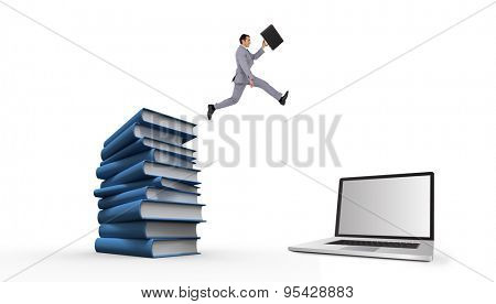Businessman running with a suitcase against stack of books