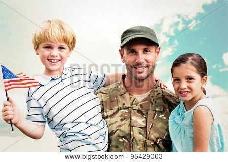 Soldier reunited with his children against blue sky