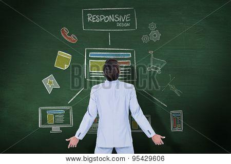 Standing businessman against green chalkboard Standing businessman on white background