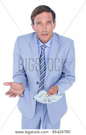 businessman holding bribe on white background
