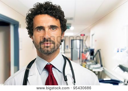Portrait of an handsome doctor in an hospital