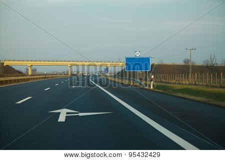 Empty highway with empty signboard
