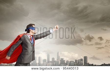 Young man in superhero costume representing power and courage