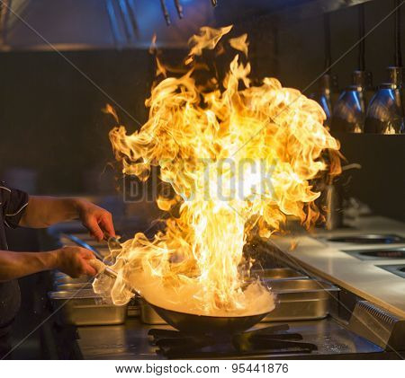 Chef cooking with flame