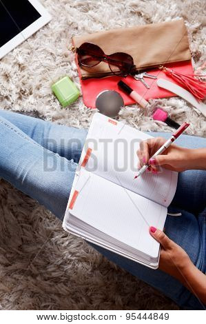 Woman Writing Into Her Desk Diary