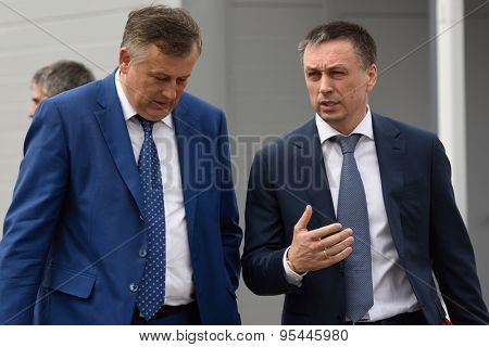 ST. PETERSBURG, RUSSIA - JUNE 30, 2015: Governor of Leningrad oblast Alexander Drozdenko (left) and chairman of Board of Directors of Amira group Andrey Saramud during the opening of Megapolis plant