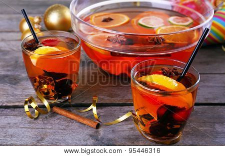 Sangria in bowl and glasses on wooden table close up