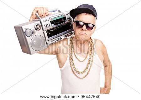 Serious senior rapper holding a ghetto blaster over his shoulder and looking at the camera isolated on white background