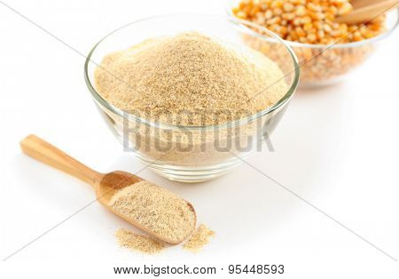 Glass bowls with flour and corn grains isolated on white