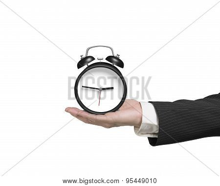Hand Holding Alarm Clock Isolated On White