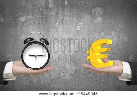 Euro Symbol And Alarm Clock With Two Hands