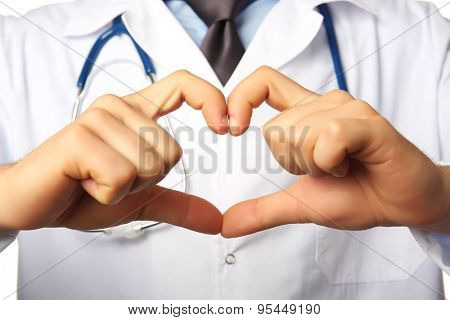 Doctor's hands making heart shape close up