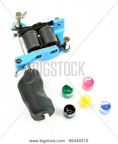 Tattoo machine with colorful ink isolated on white
