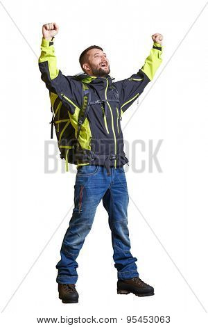 full length portrait of happy hiker with backpack raising his hands up and looking up. isolated on white background