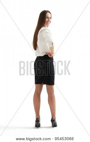 businesswoman in formal wear turning around, looking at camera and smiling. isolated on white background