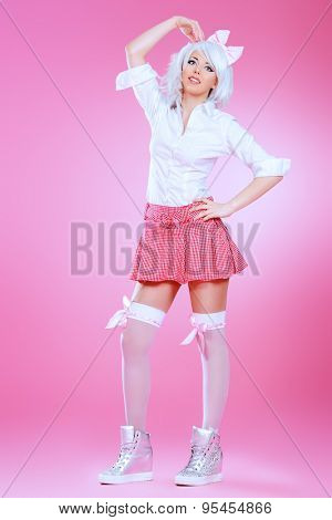 Full length portrait of a cute teen girl wearing white wig and school uniform with stockings posing over pink background. Anime style.