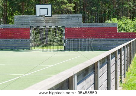 Soccer Goal And Basketball Hoop On Universal Outdoor Playground With Synthetic Field And Wooden Fenc
