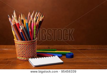 School stationery on wood background.   Back to school concept.