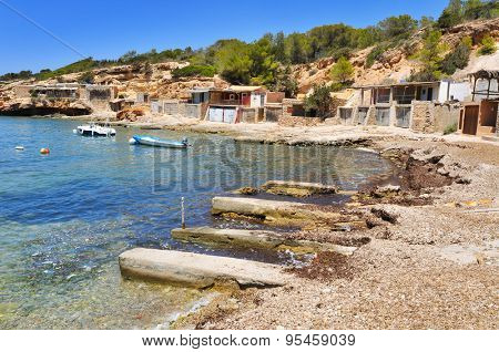 a view of the Cala Corral cove in Ibiza Island, Spain, with its traditional fishermen shelters