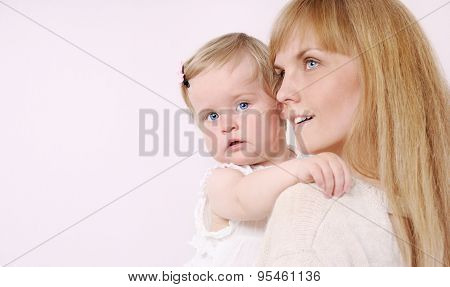 Family Portrait Of Caring Mother And Her Cute Little Baby Girl