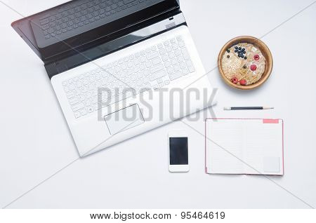 Work Place With Cereal Breakfast And Personal Organizer