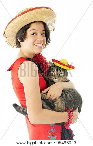 A beautiful young teen happily holding her pet tabby cat, both dressed to celebrate Cinco de Mayo.  On a white background.