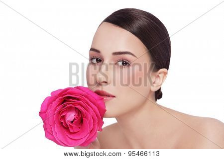 Portrait of young beautiful healthy woman with fancy pink rose over white background