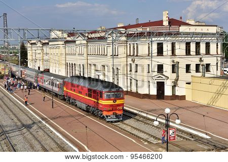 TULA, RUSSIA - MAY 23, 2015: Passenger train on the railroad station Moskovsky. The station building was erected in 1913 and then reconstructed in 1952-1955