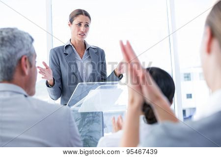 Business team applauding their colleague in the meeting room