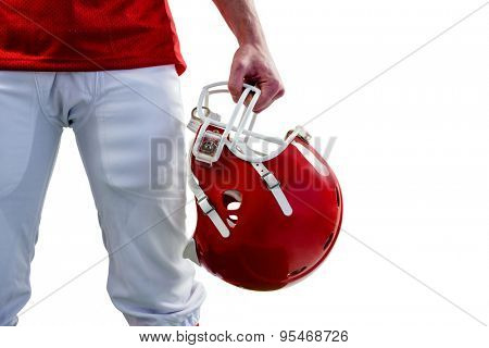 An amercian football player taking his helmet on hand with white background