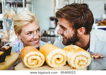 Cute couple on a date looking at each other at the bakery