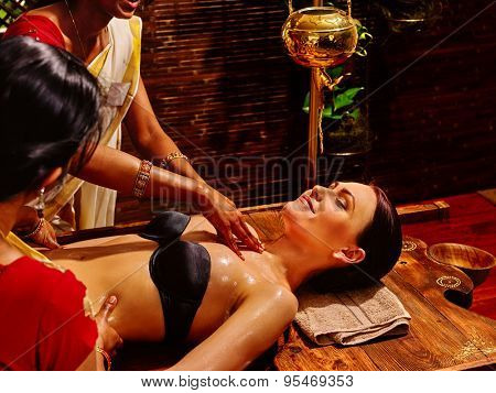 Young woman having neck Ayurveda spa treatment