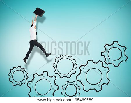 Businessman leaping with his briefcase against blue vignette background