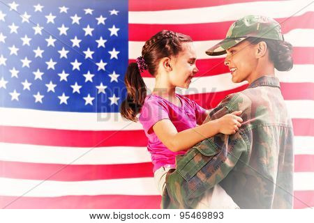 Solider reunited with daughter against rippled us flag