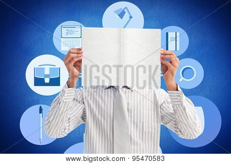 Businessman holding a white card covering his face against blue background