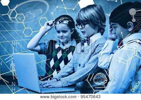 Science graphic against school kids using laptop in classroom