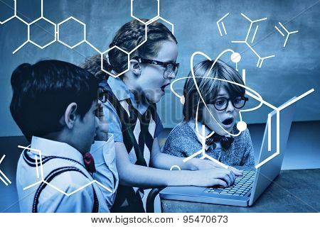 Science graphic against shocked little school kids using laptop
