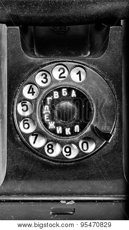 rotary dial of old dirty broken phone