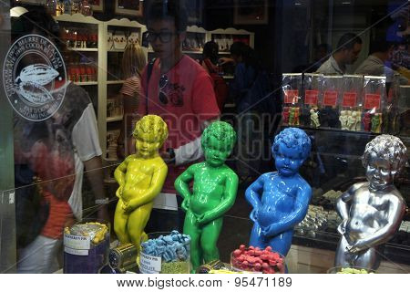 BRUSSELS, BELGIUM - AUGUST 13, 2012: Multicoloured copies of the Manneken Pis in a chocolate shop in Brussels, Belgium.