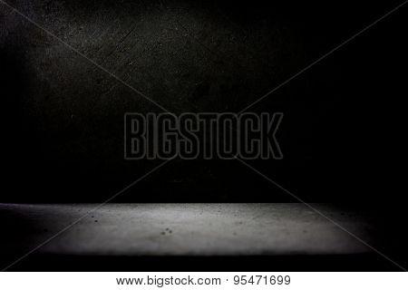 Dark stone wall and floor.