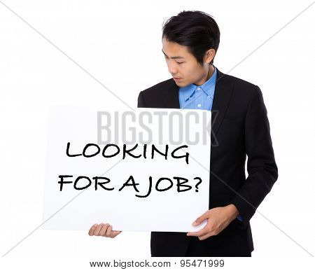 Confident businessman holding a poster showing with looking for a job phrases