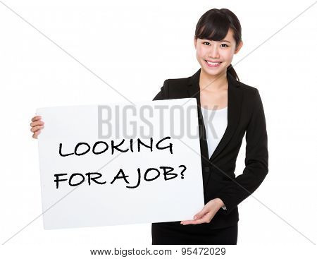 Beautiful businesswoman showing a poster showing with looking for a job phrases