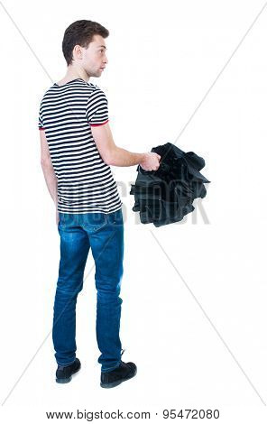 Back view of man in jeans  with umbrella. Standing young guy. Rear view people collection.  backside view of person.  Isolated over white background. The guy in the striped shirt covers the umbrella