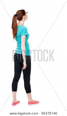 back view of standing young beautiful  woman. girl  watching. Rear view people collection.  backside view of person.  Isolated over white background. Sports girl is covering her eyes from the sun.