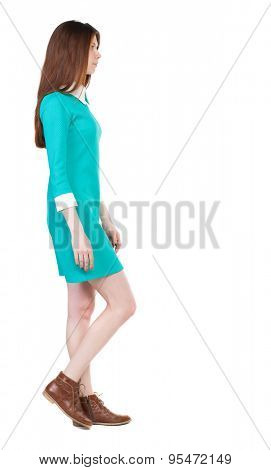 back view of walking  woman. beautiful girl in motion.  backside view of person.  Rear view people collection. Isolated over white background. girl in a stylish vintage dress goes to the right.